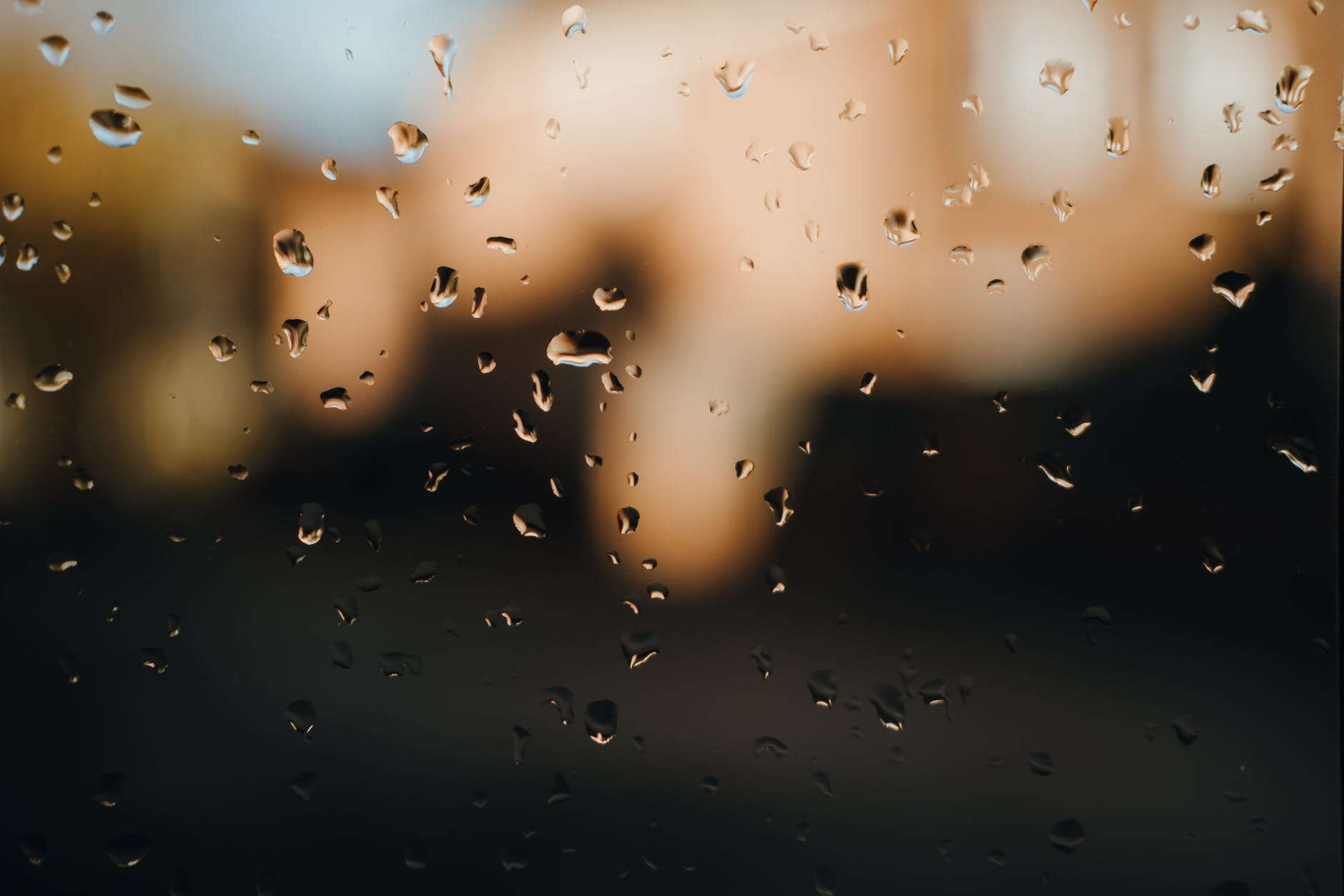 background of droplets on window during rain